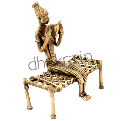 Dhokra Lady Sitting on a Cot